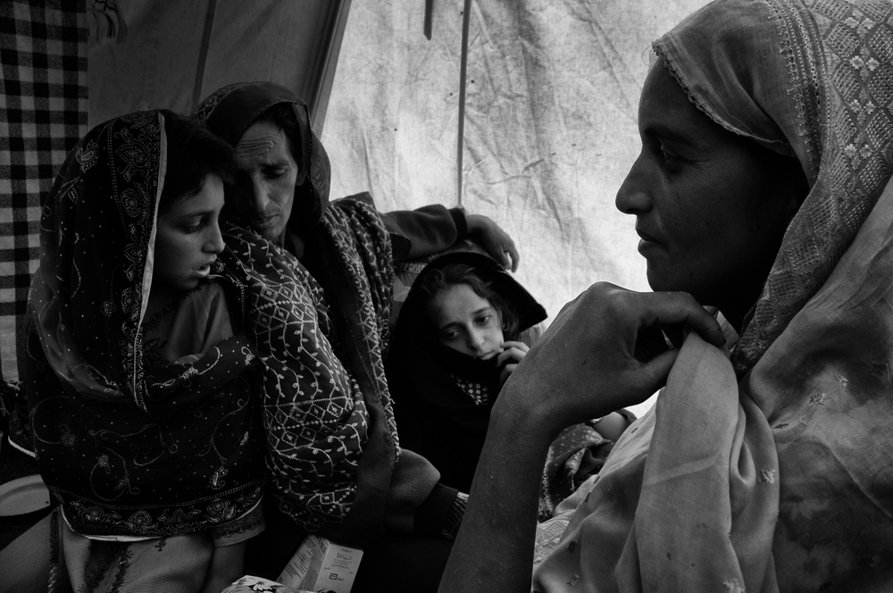 A family wait in a field hospital for medical help in Bagh, Kashmir, Pakistan, October 13, 2005. (Photo / Mark Pearson) The massive October earthquake in Kashmir affected one of the highest and most remote places on earth. Difficult terrain slowed the relief effort and the largest scale humanitarian air operations since the Berlin blockade began.