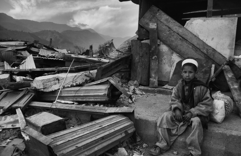 A young boy in the rubble during   Eid  al-Fitr in  Balakot, NWFP, Pakistan, November 11, 2005. (Photo / Mark Pearson) The massive October earthquake in Kashmir affected one of the highest and most remote places on earth. Difficult terrain slowed the relief effort and the largest scale humanitarian air operations since the Berlin blockade began.