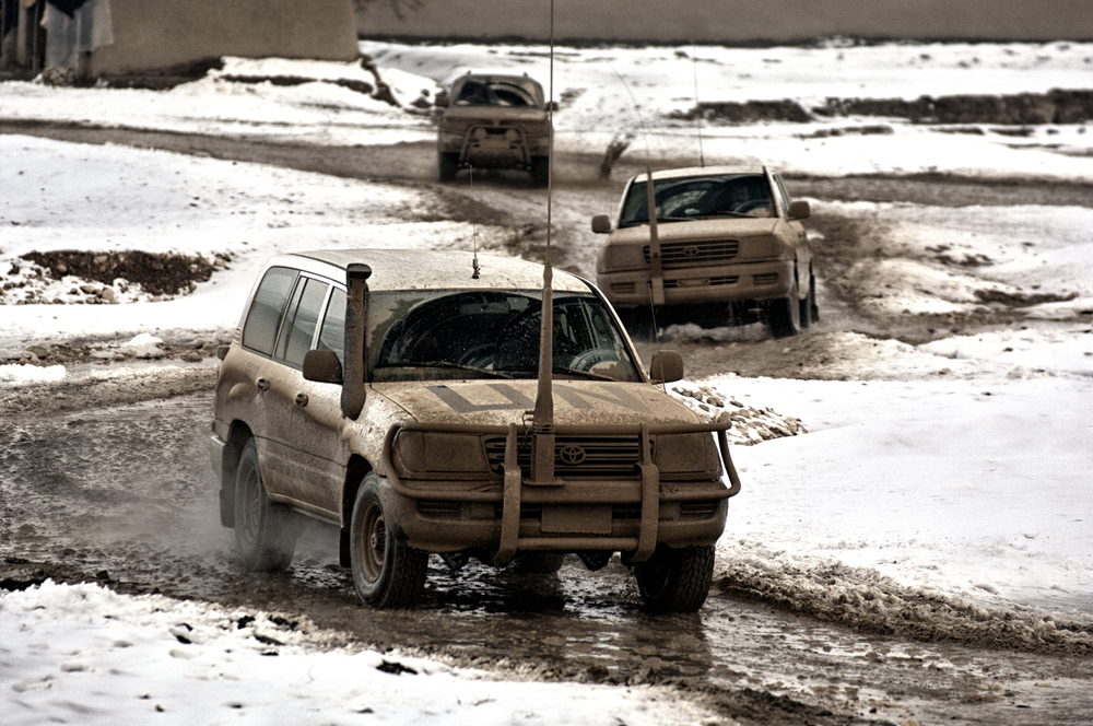 UN Toyota Land Cruisers driving through and mud and snow in Maymana, Faryab Province, Afghanistan, February 14, 2008. (Photo/Mark Pearson)