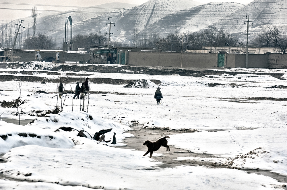 People walking through the snow in Faryab Province, Afghanistan, February 14, 2008. (Photo/Mark Pearson)
