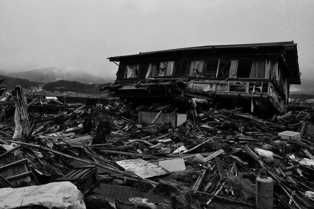 The Government of Japan estimated that the   2011 Tōhoku earthquake and tsunami destroyed 120,000 buildings, damaged 220,000 others, and washed another 78,000 buildings into the sea. A house in Ofunato, Iwati Prefecture, March 26, 2011. (Photo/Mark Pearson)