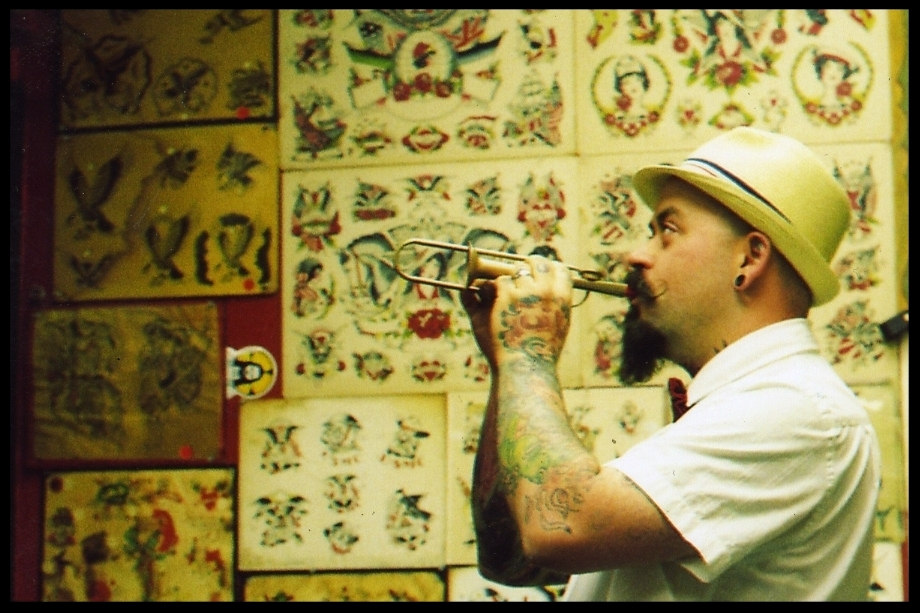 Tilt is a professional tattooer who resides in Champaign, Illinois, where he has owned and operated NewLife Tattoos since 2001. Tilt is a tattoo history enthusiast and a collector of antiques. He is committed to studying and carrying onthe tradition of tattooing