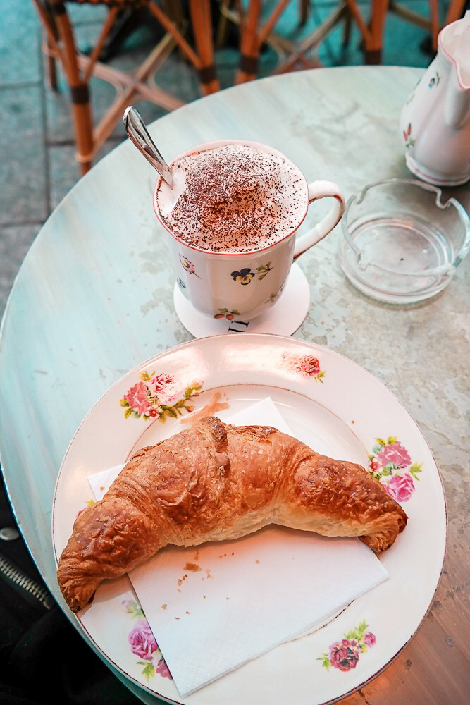 A fresh croissant and cappuccino at L'Eclair in Paris