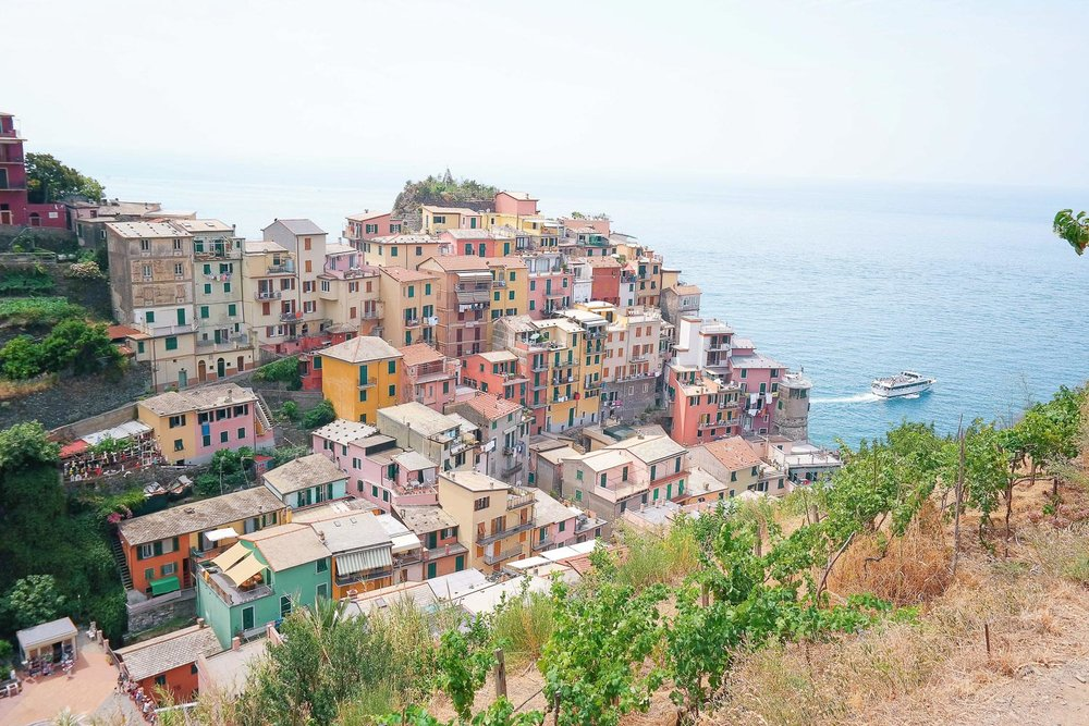 A rainbow assortment of houses in Cinque Terre as seen from the hiking trails