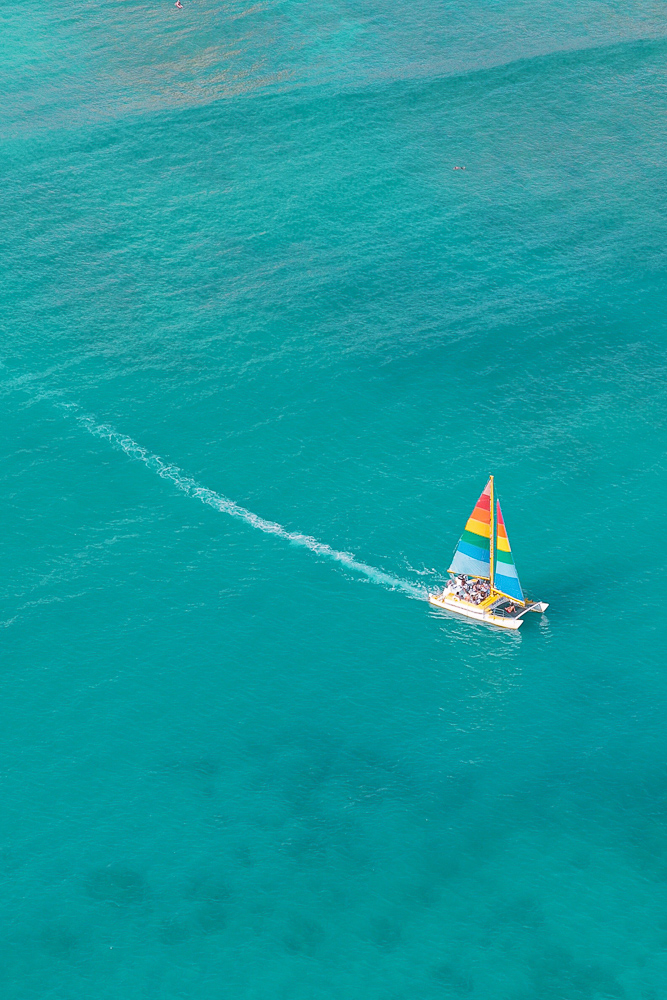A lone sailboat seen from my helicopter tour