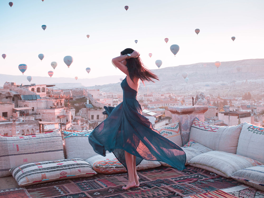 Travel influencer @theboldbrunette twirlin' around in her favorite place of all time