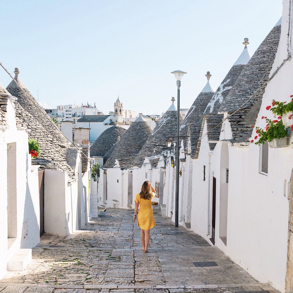 Exploring Alberobello in Puglia, Italy on a sunny July morning