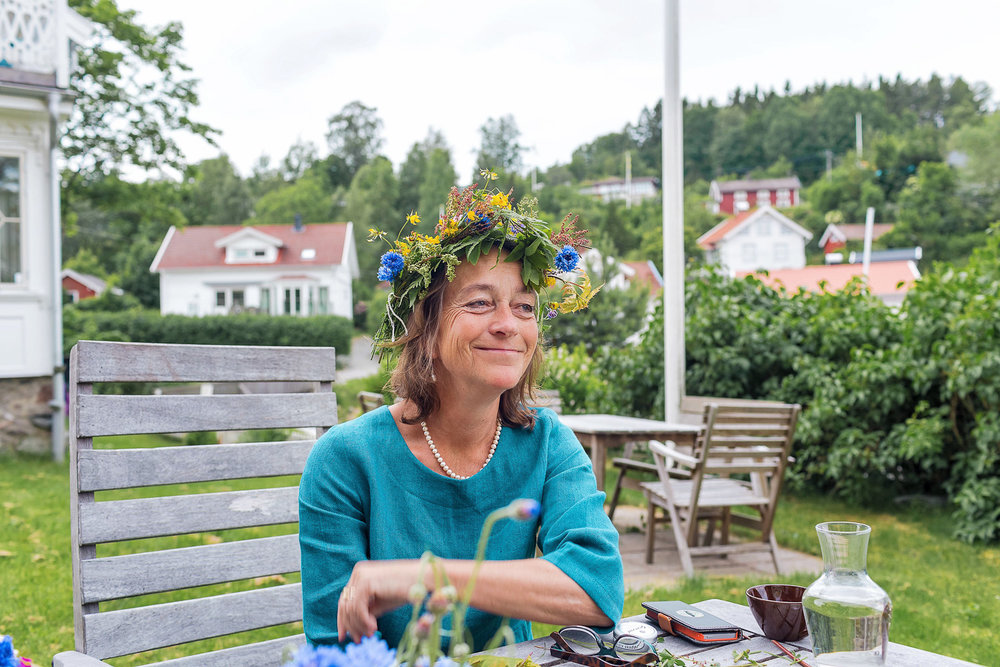 Vibs, the sweet owner of Slussen Pensionat, in her Midsummer flower crown