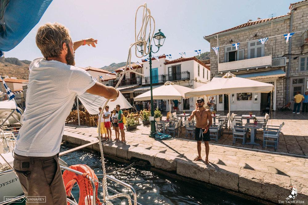 The Yacht Week docking in Hydra, Greece