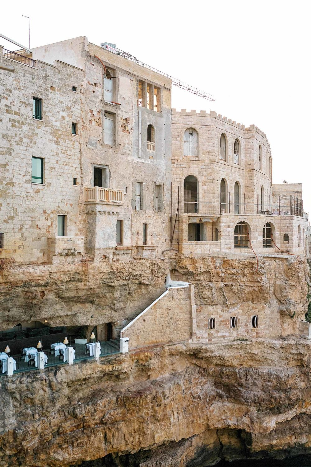 Everything you need to know about visitingGrotta Palazzese, that famous cave restaurant in Puglia, Italy you see all over Pinterest!