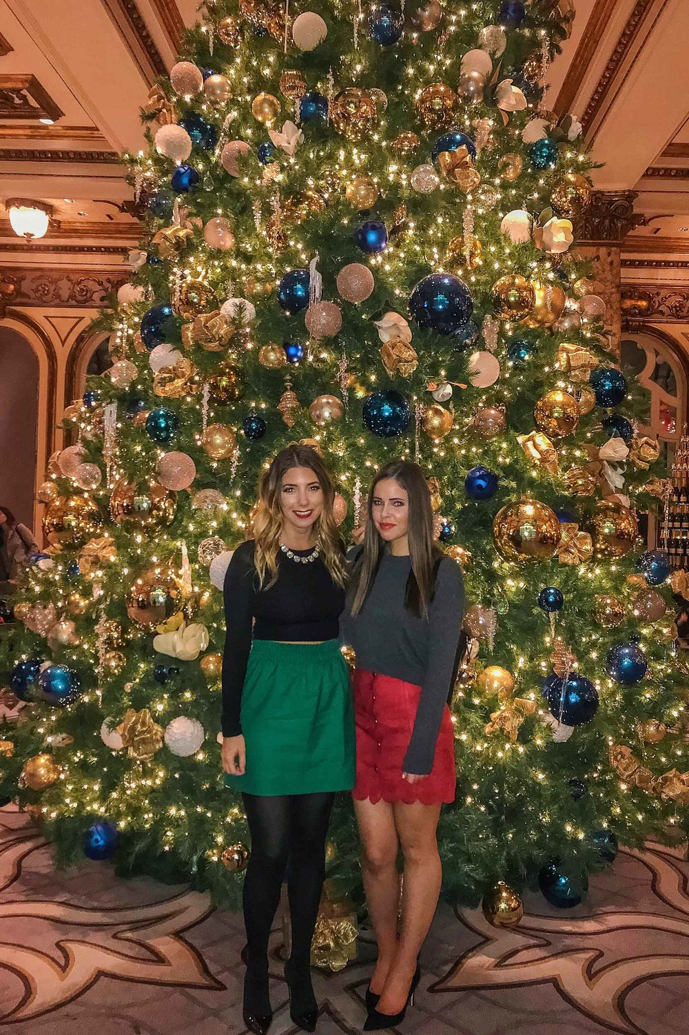 In front of the 23-foot tall Christmas tree at The Fairmont in SF after holiday gingerbread tea time