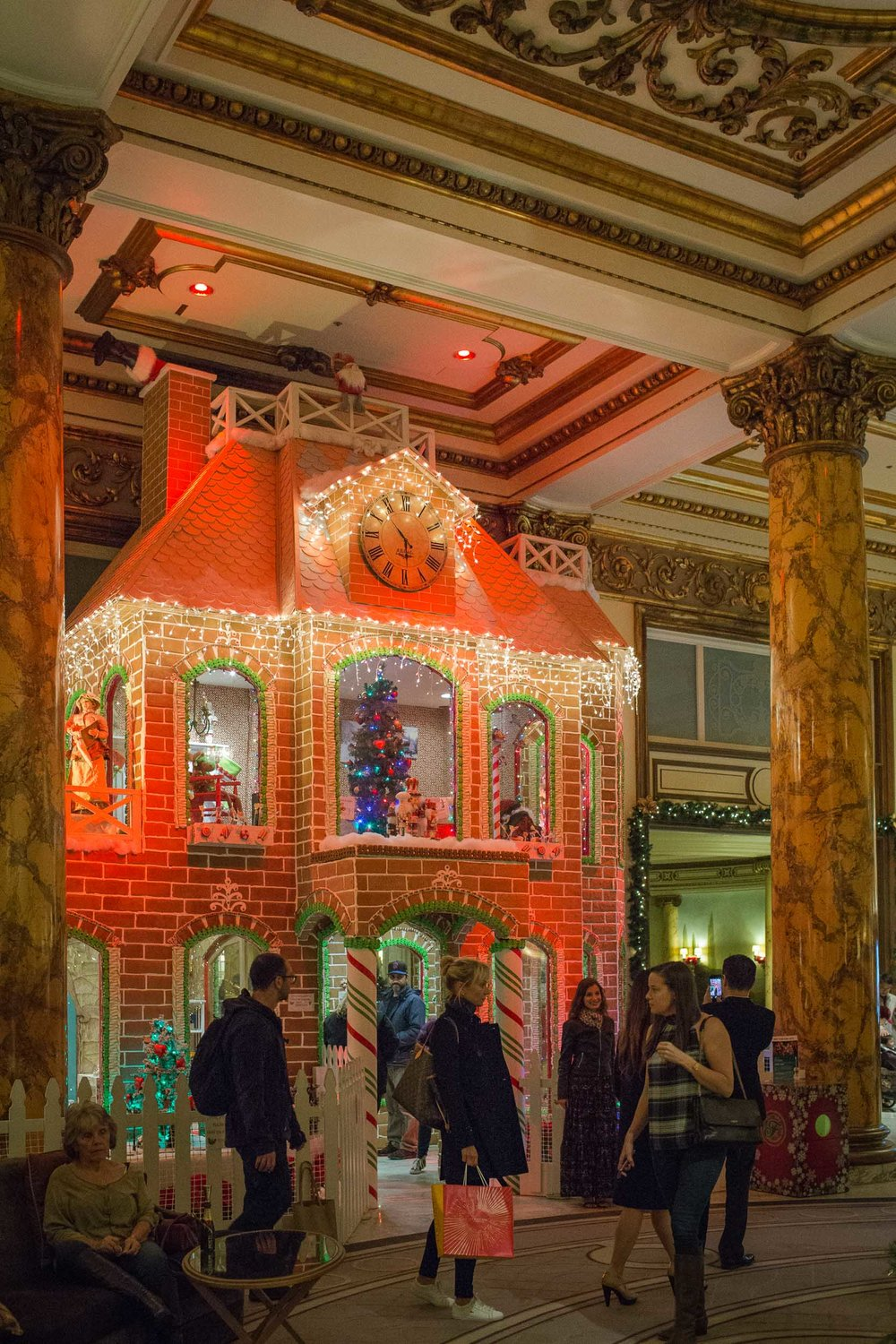 The lobby of The Fairmont San Francisco at Christmas time features a 23-foot tree and a real, two-story Gingerbread House!