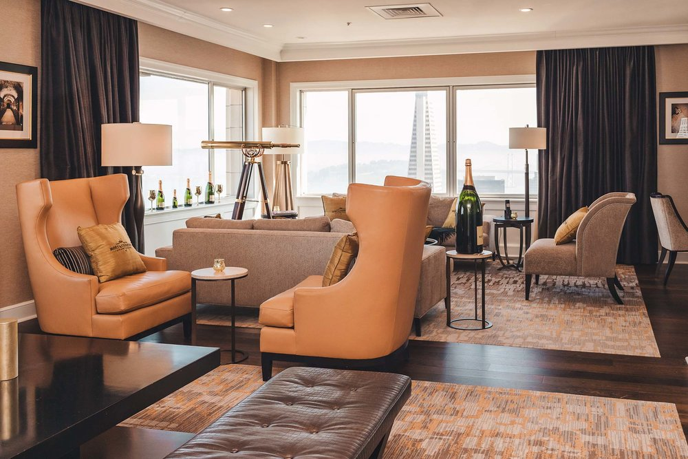 The huge living room in the Presidential Suite has room for 20 people and is great for celebrations!