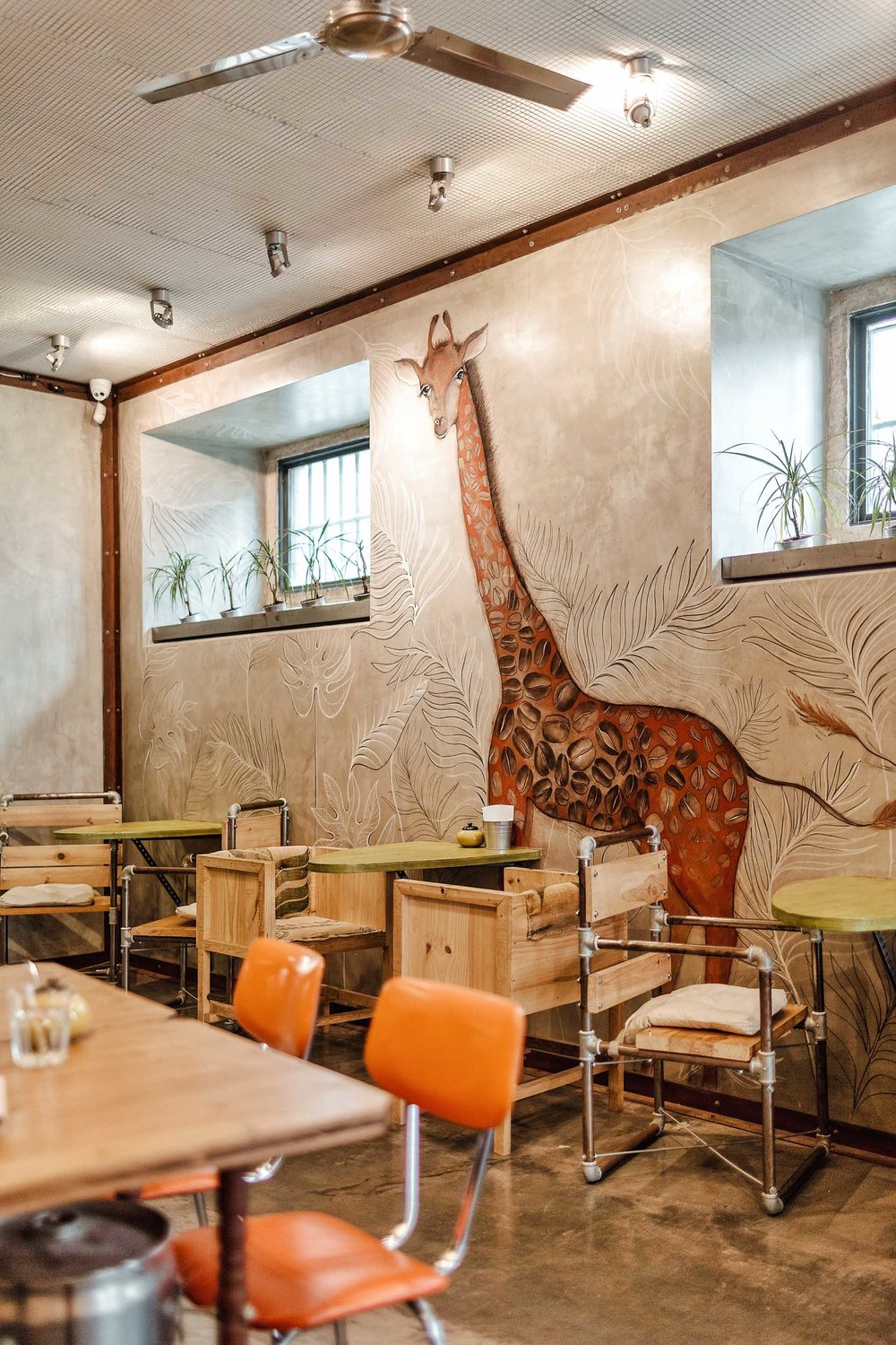 The interior of Fabrica Coffee Rosters in Lisbon.  The giraffe's spots are coffee beans!
