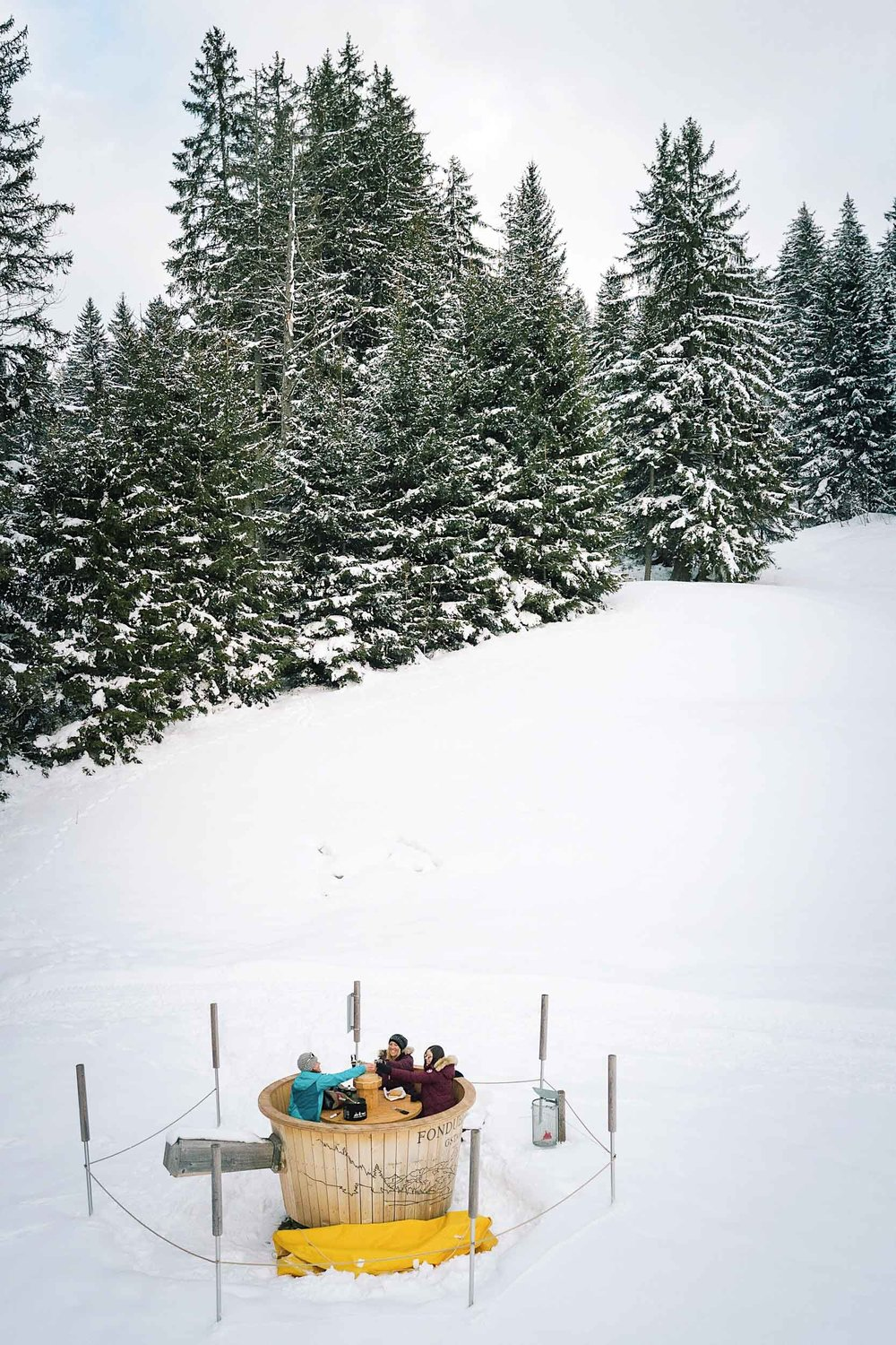 Making fondue in the middle of the Alps after a hike in Fondueland Gstaad Switzerland