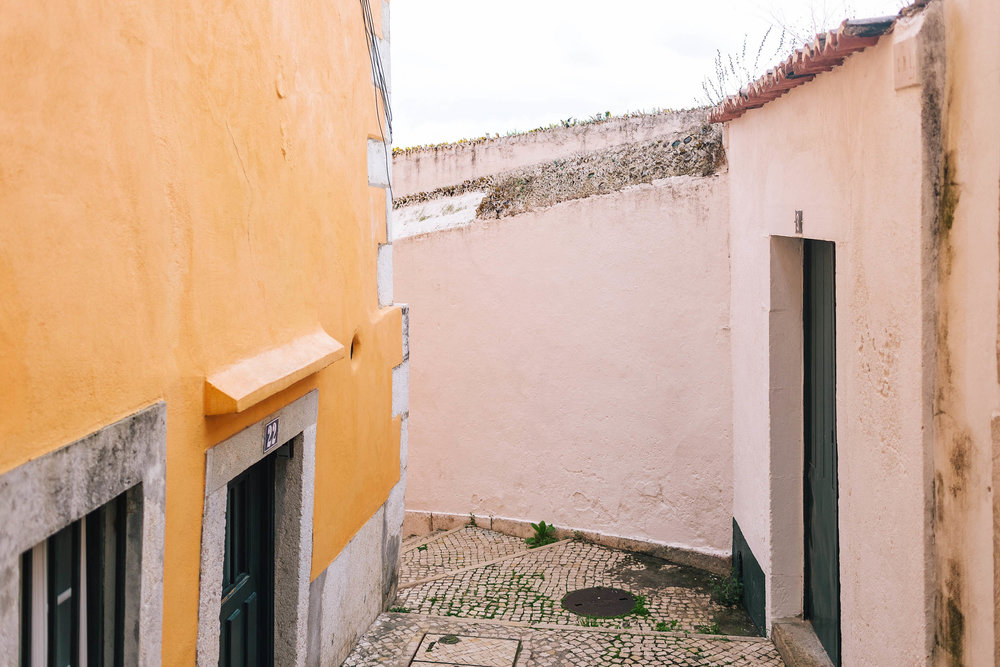 Make sure to spend time roaming Alfama when visiting Lisbon