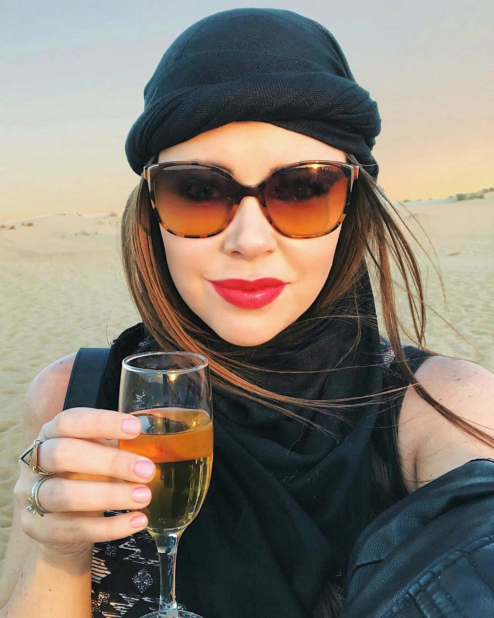 Drinking sparkling juice at the Platinum Heritage desert safari