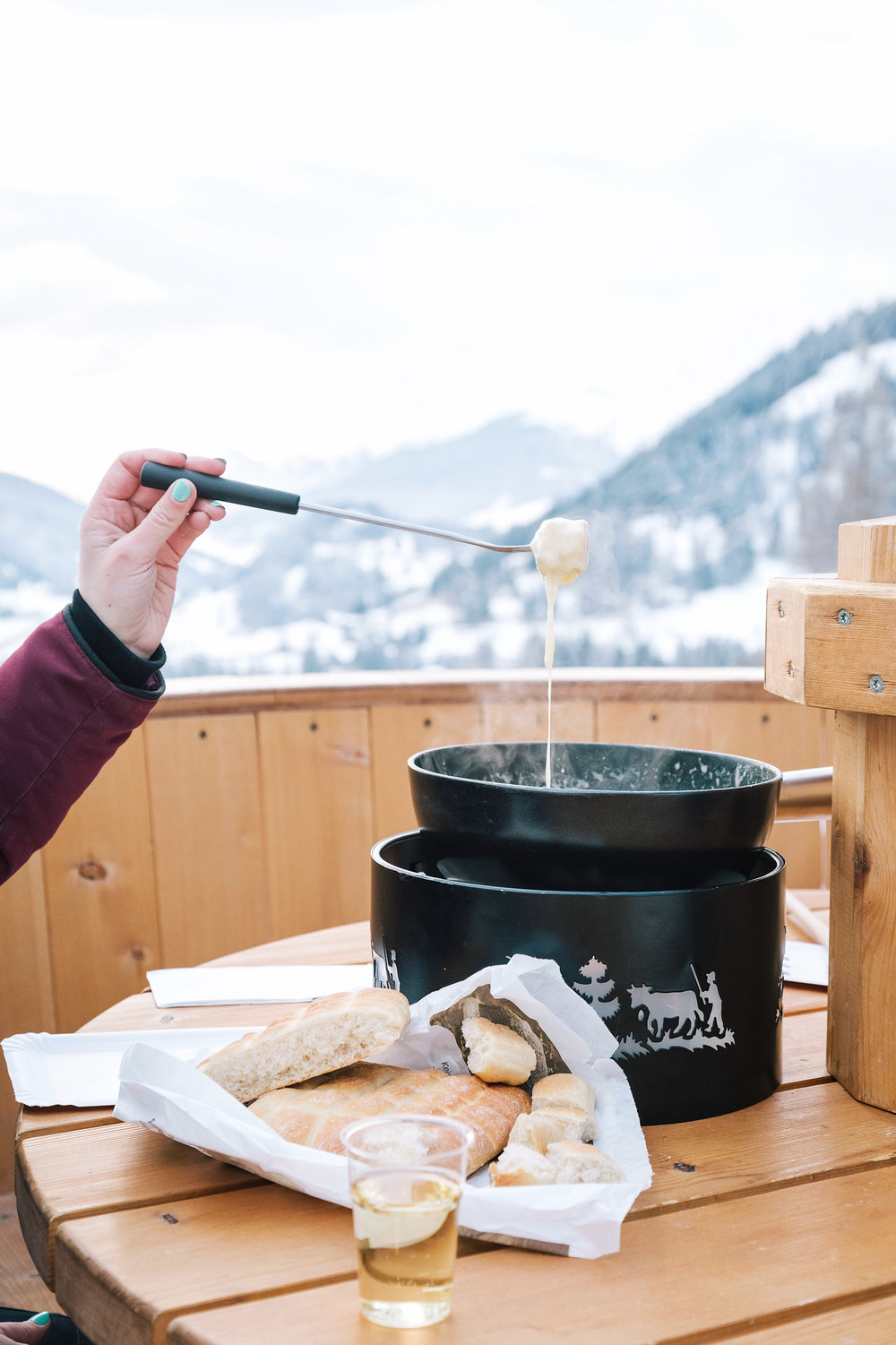 Making fondue in the middle of the Swiss Alps