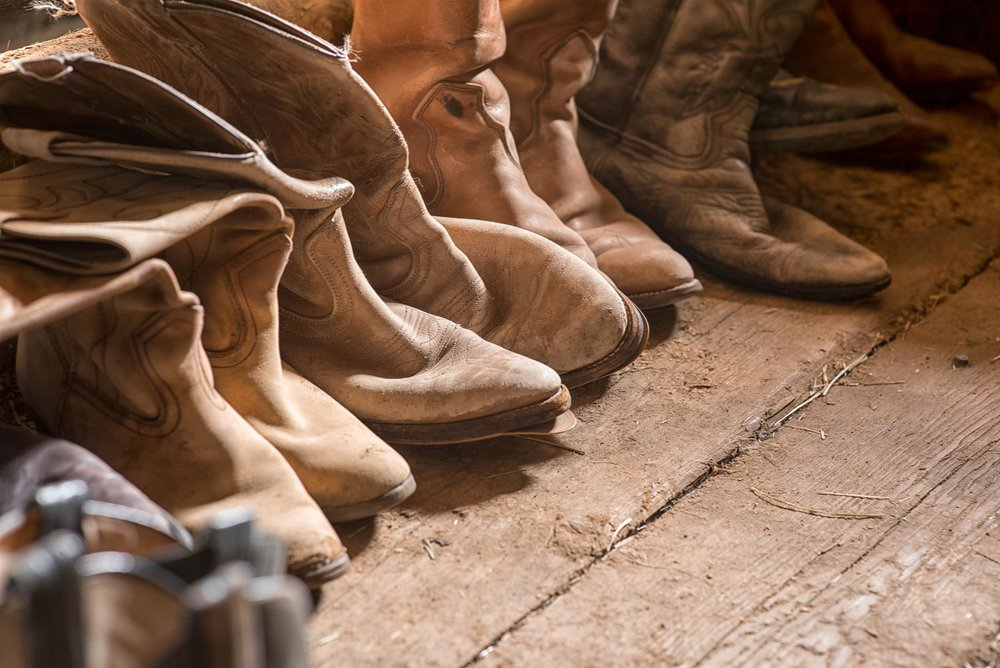 Cowboy boots at Watch Lake Lodge. Credit: Destination BC/Michael Bednar