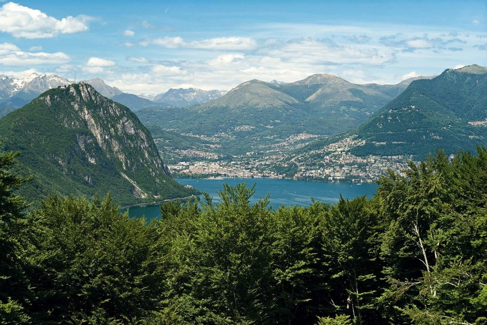 UNESCO World Heritage Monte San Giorgio in Ticino. View from Monte San Giorgio towards Lugano, Monte San Salvatore on the left, Monte Bre on the right.
