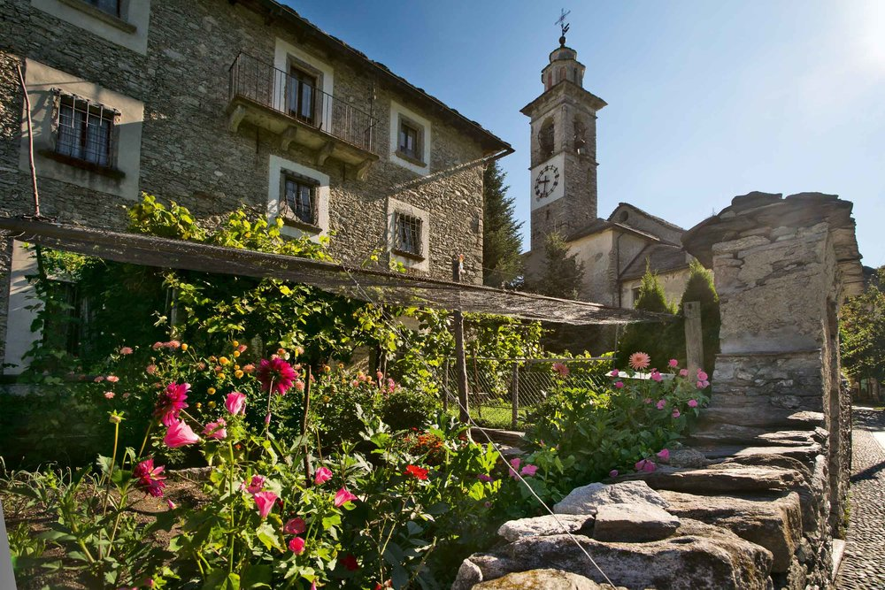 The church tower of St. Anne in Rasa in the Centovalli. Rasa is one of the smallest municipalities in Ticino. Only about 20 people live here year round. Copyright by: Switzerland Tourism
