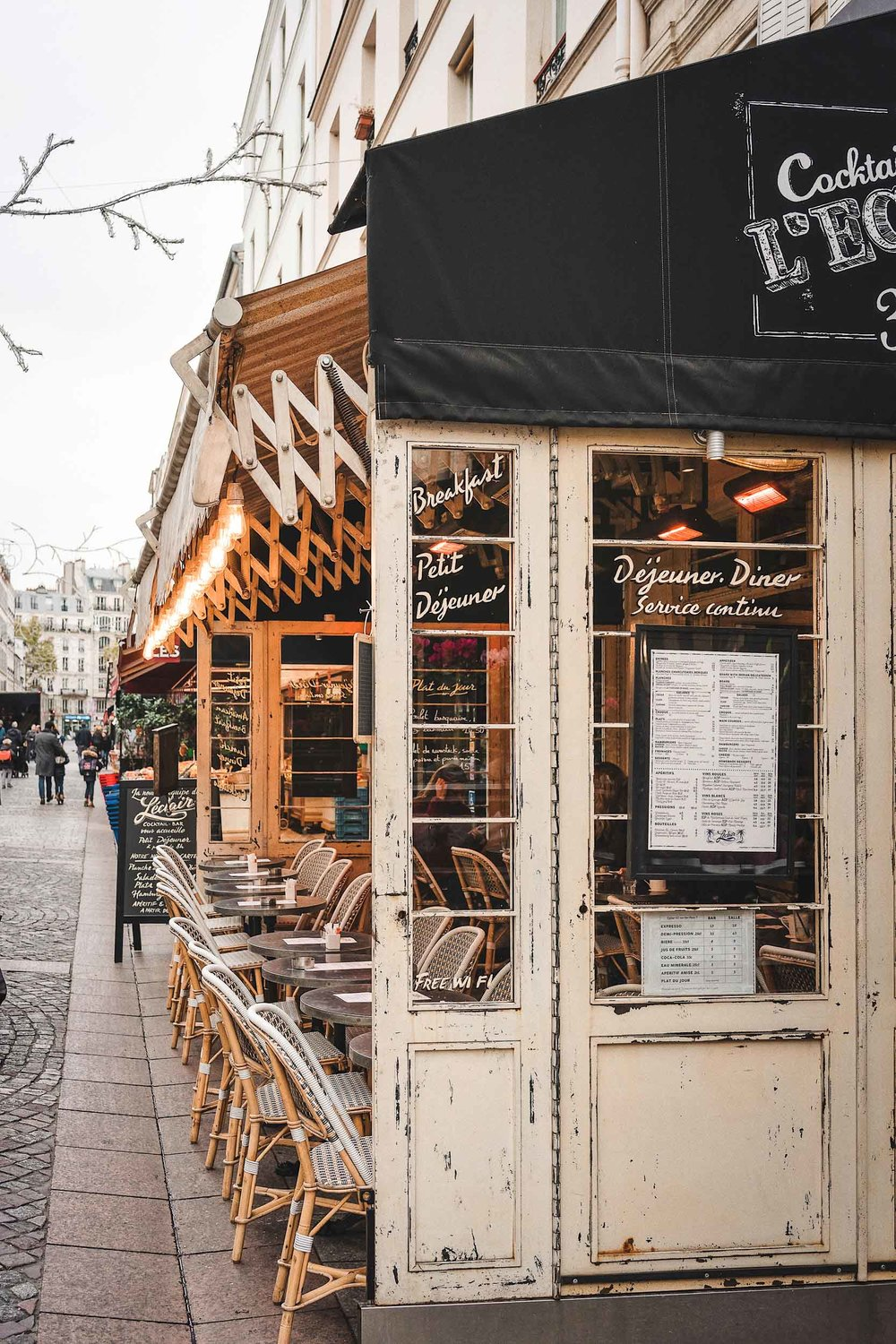 Things you can't miss on your Paris itinerary: stroll through Rue Cler and stop at L'Eclair for cocktails
