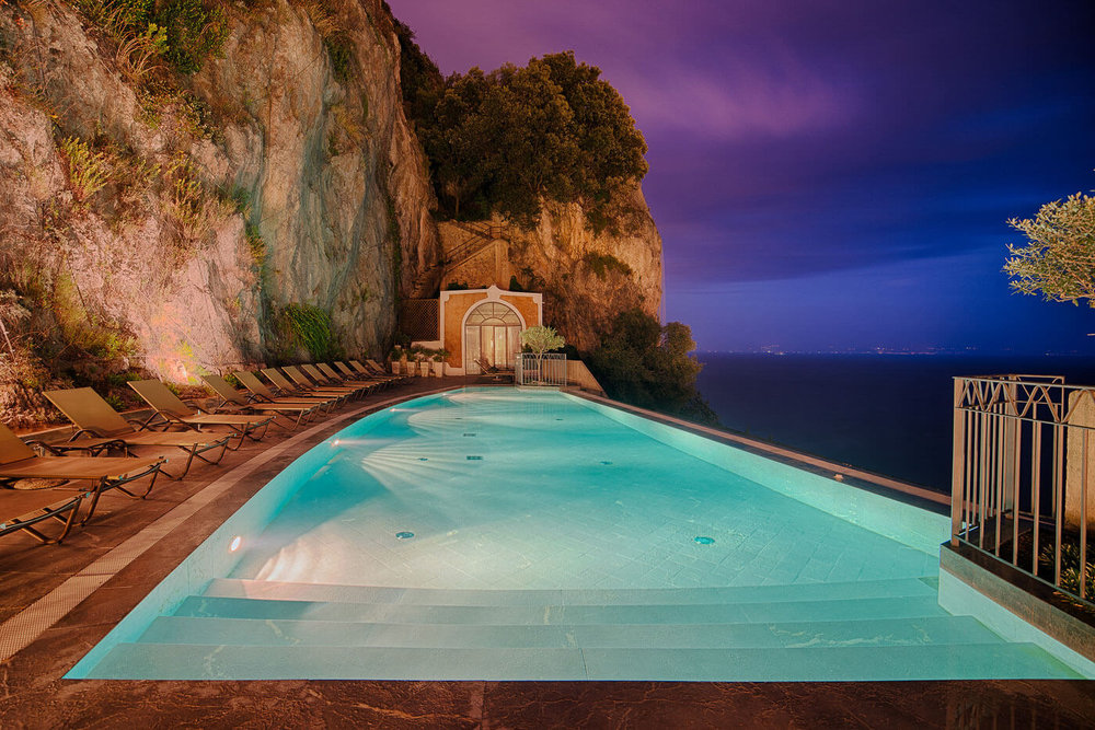 Nighttime pool views at luxury hotel Amalfi NH Collection Grand Hotel Convento di Amalfi