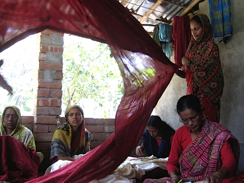 Bengal women creating scarves and blankets for Amba Gallery