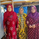 Dalal is in the middle and is standing in the doorway of her tent. We loaned $100.
