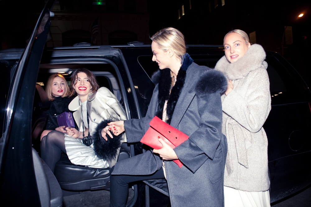 After bundling up in their warmest coats, the girls hop into a car and head to the party together.