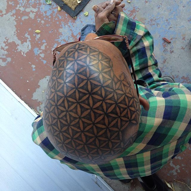 I like my self- full head tattoo,flower of life,scared geometry. This is what happens when your inspired at tattoo expo in Denver Co.Oh, gawd me love it!
