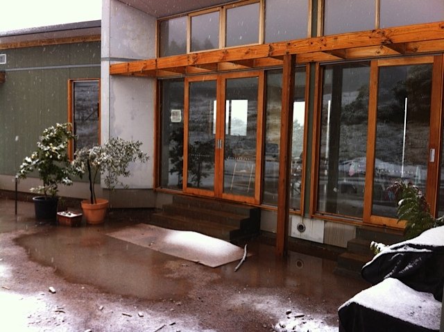 Alpine House - courtyard doors under snow 20 July 2013.jpg