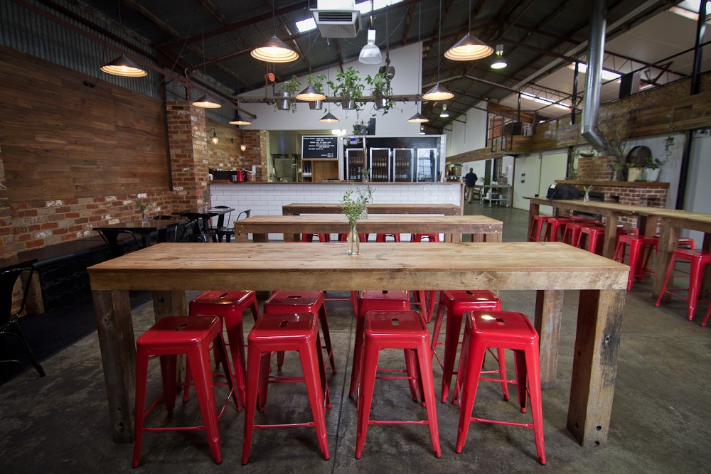 Auswest Timbers HOSPITALITY COMMENDATION:   The Public Brewery by Bekendales Design Co., Australia   Finding an old dilapidated shed, which was once the local area's feed and grain store, was the perfect start to creating the Public Brewery venue. The owners were committed to the idea of using recycled and refurbished materials wherever possible for the fitout of the venue. There was a shout out to the community of any discarded products and finding things as they went. Subsequently the design of the interior of the venue was an organic process and unorthodox. They worked backwards really, using what they found, rather than deciding on a design and having things made from plans.  Although the focus on using recycled and reclaimed materials was always the driving force behind their choices of materials and pieces, they remained focused on the final objective - they were creating a venue that would welcome and service customers from a wide ranging demographic. They wanted a venue where the customers would not know unless they were told, that the majority of the fitout has been sourced second hand. They really have achieved that goal and the venue is a perfect example of how using recycled and reclaimed materials can result in a polished and sophisticated venue.