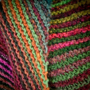 Bias knit garter stitch scarf in Noro Kureyon by Cate Carter-Evans