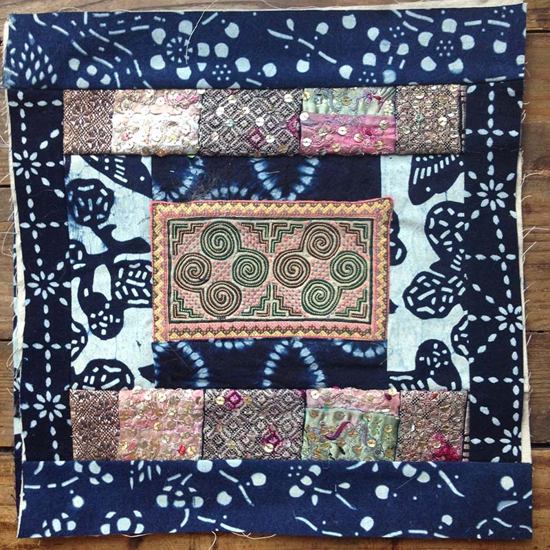 Quilt block with Hmong embroidery by Cate Carter-Evans
