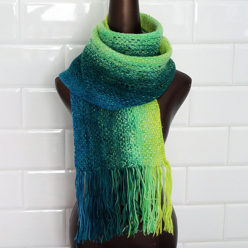 - son of a stitchWith a five color gradient and tie-as-you-go fringe, this linen stitch scarf makes a bold color statement with a unique woven lookThis pattern can be worked with lengths of yarn under 5 y / 4.6 m, and this pattern includes a tutorial for the clasp-weft join which eliminates the need to weave in any ends at all!Requires 1000 y / 915 m total of sport-weight or fingering-weight yarn, 200 yds x 5 colors. Yarn is held double throughout.Pattern available here.