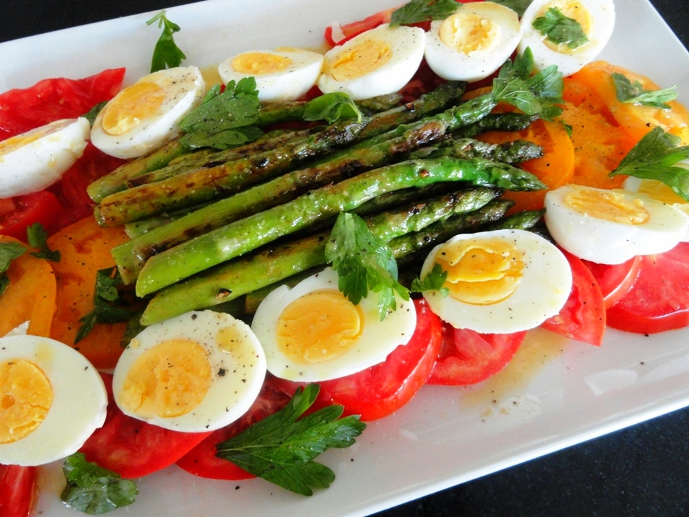 Red and golden heirloom tomato, grilled asparagus, and hardboiled egg with parsley and red wine vinaigrette