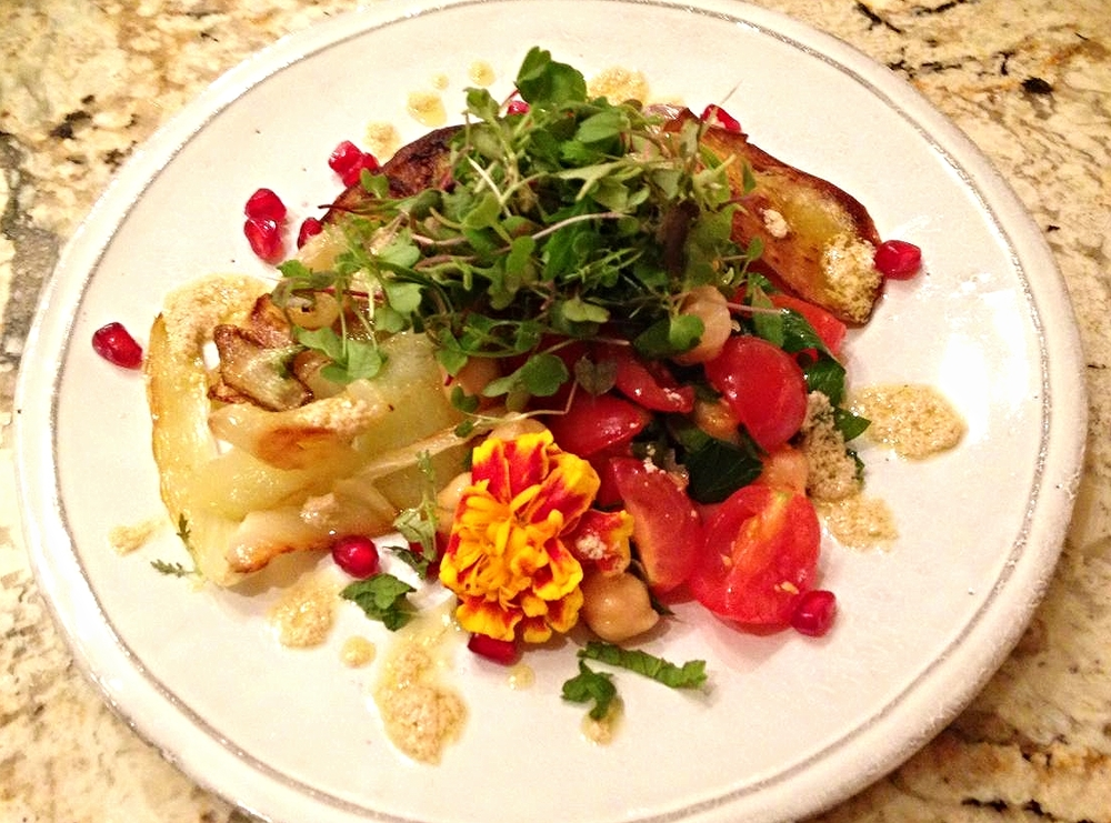 Roasted cauliflower, eggplant, tomato, and chickpea salad with pomegranate, microgreens and lemon-tahini dressing