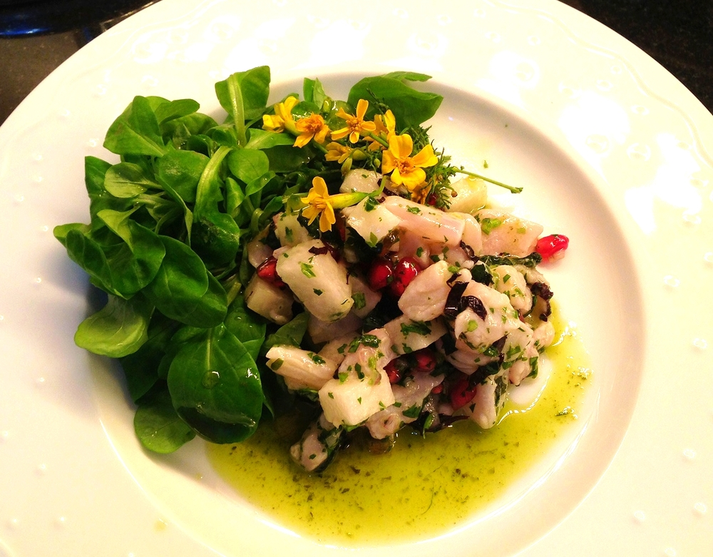 Sea bass ceviche with herb oil, pomegranate, opal basil, and edible flowers