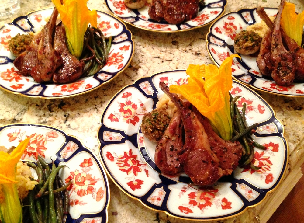 Lamb chops scottadito with herbs de Provence, stuffed mushrooms, French green beans, and zucchini flower