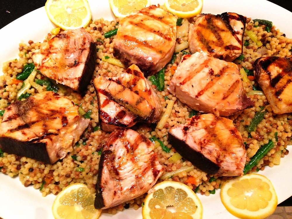 Grilled swordfish steaks on Israeli couscous with green and wax beans, herbs, and lemon citronette