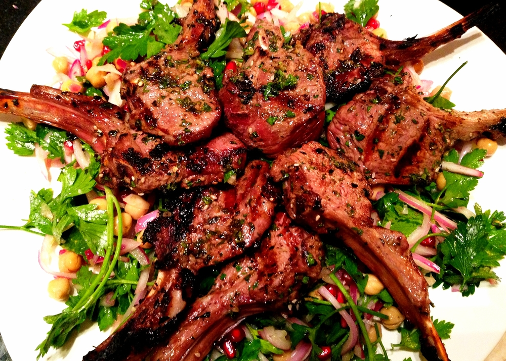 Moroccan spiced grilled lamb chops on parsley, chickpea, red onion, and pomegranate salad