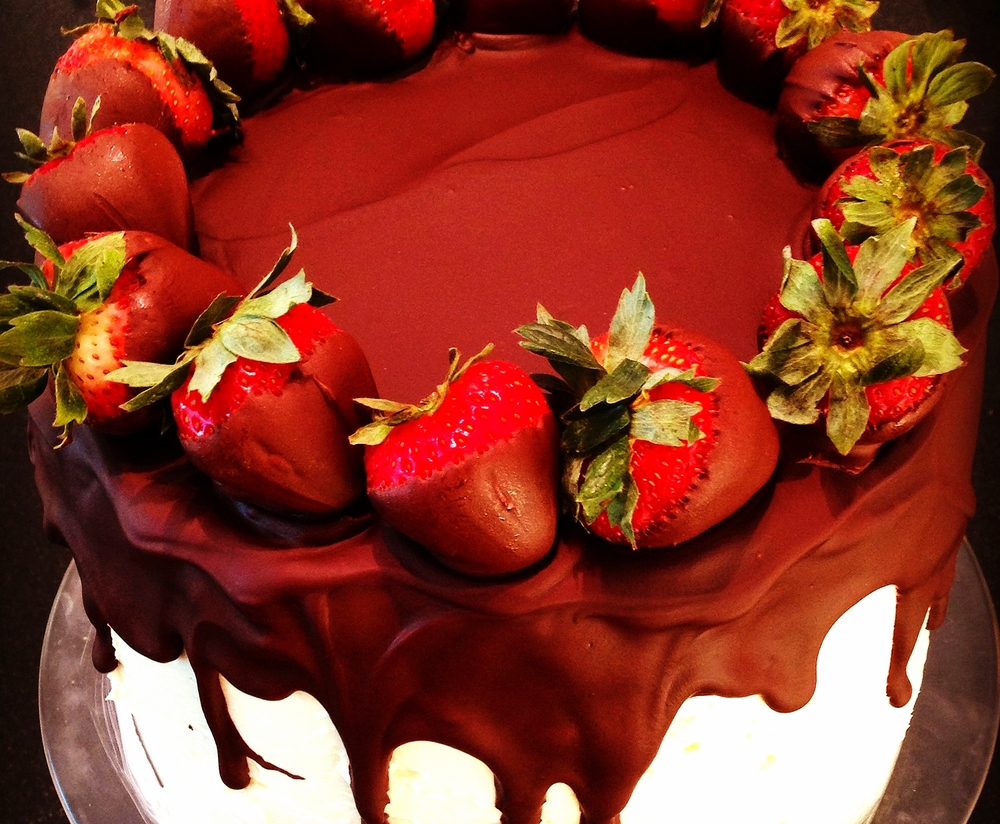 Shadow cake topped with chocolate dipped strawberries