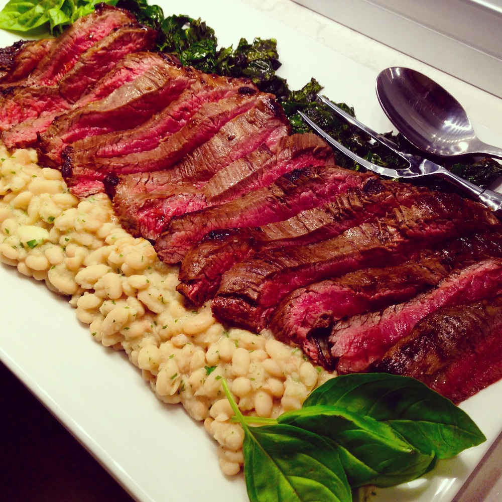 Sliced beef tagliata, Tuscan kale, and roasted garlic-rosemary cannellini beans