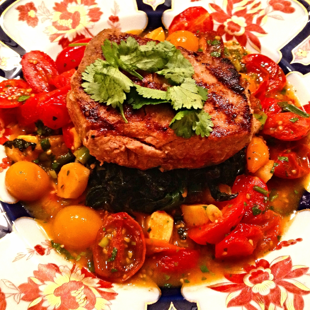 Tuna steak on Indian-spiced chard and warm tomato-ginger-cilantro sauce
