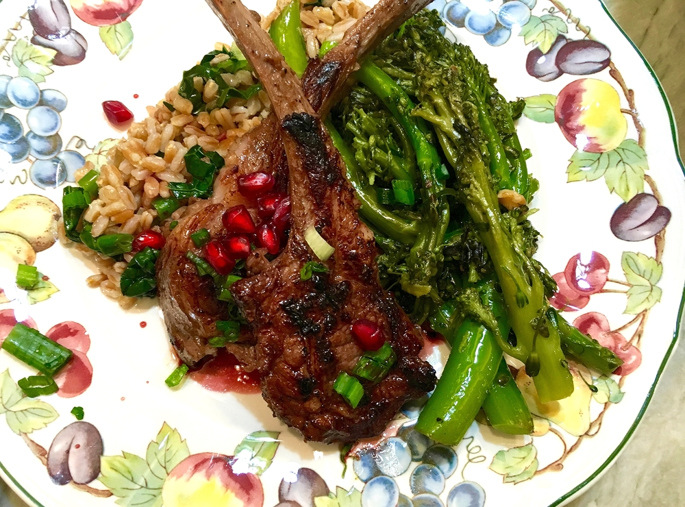 Lamb chops on warm herbed farro salad, brocoletti, spiced wine-pomegranate sauce