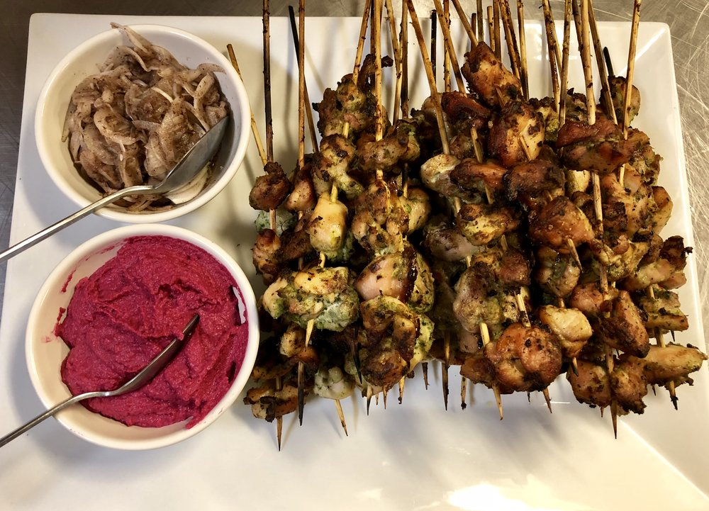 Green herb-marinated locally farmed chicken kebabs, sumac onions, beet hummus