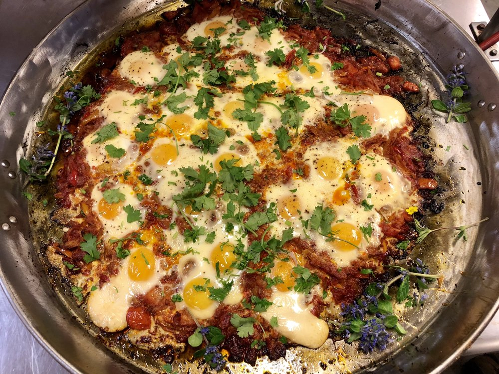 Lightly smoked shakshuka with Marble House Project eggs and herbs