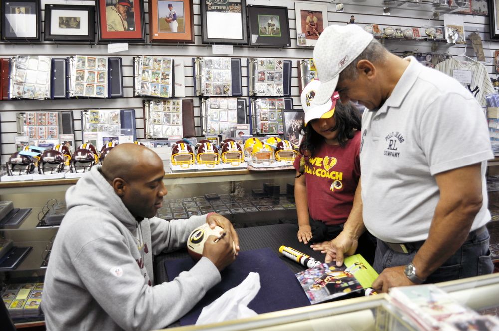Father and Daughter Redskins fans meet DeAngelo Hall in our store on October 19, 2013.