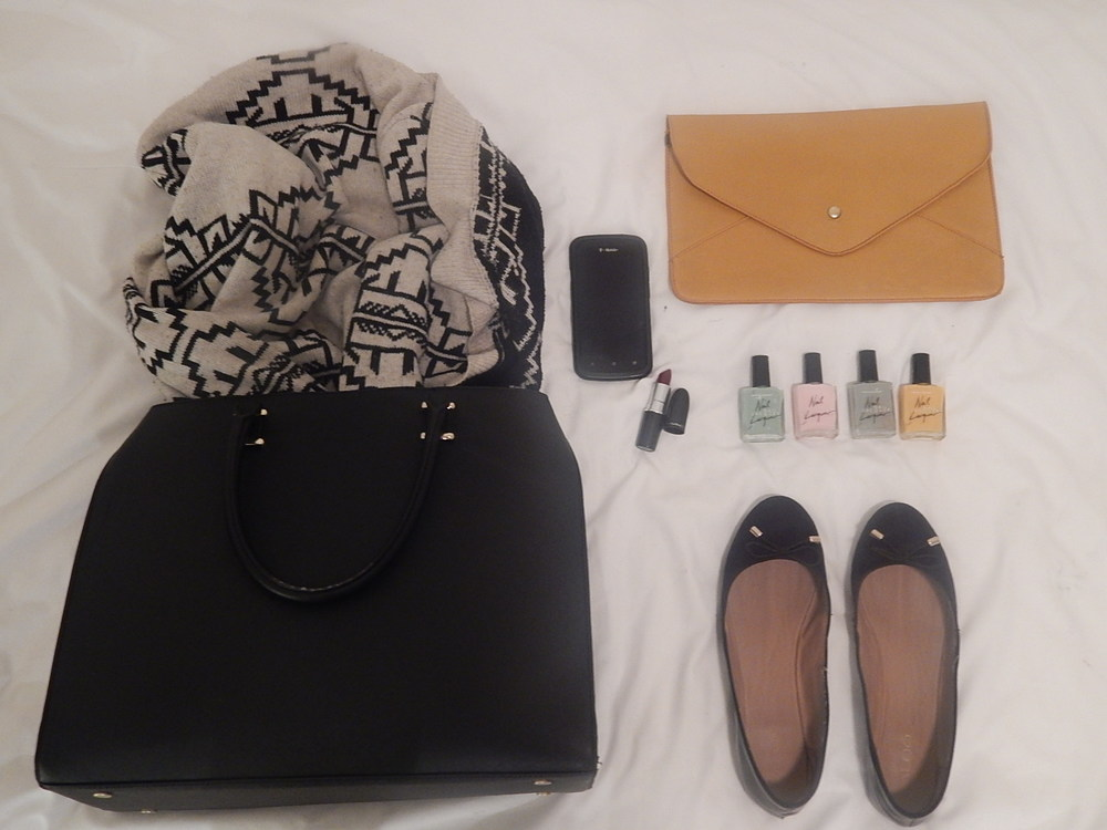 1. Large Black and gold H&M Tote / 2. Black and cream-colored Urban Outfitters sweater / 3. Black HTC One Android /4. MAC lipstick in Diva (A43) / 5. Mustard clutch from Francesca's Collections / 6. American Apparel nail polish in (l-r): Office, Coney Island, Echo Park, and Manila / 7. Ballet flats from Aldo Accessories